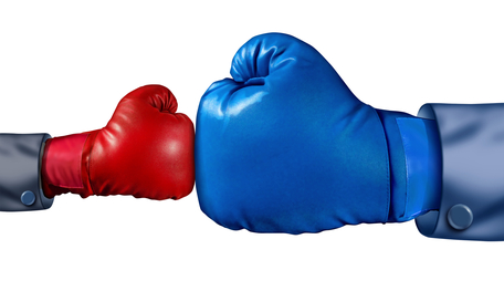 blue boxer glove and red boxing glove touching
