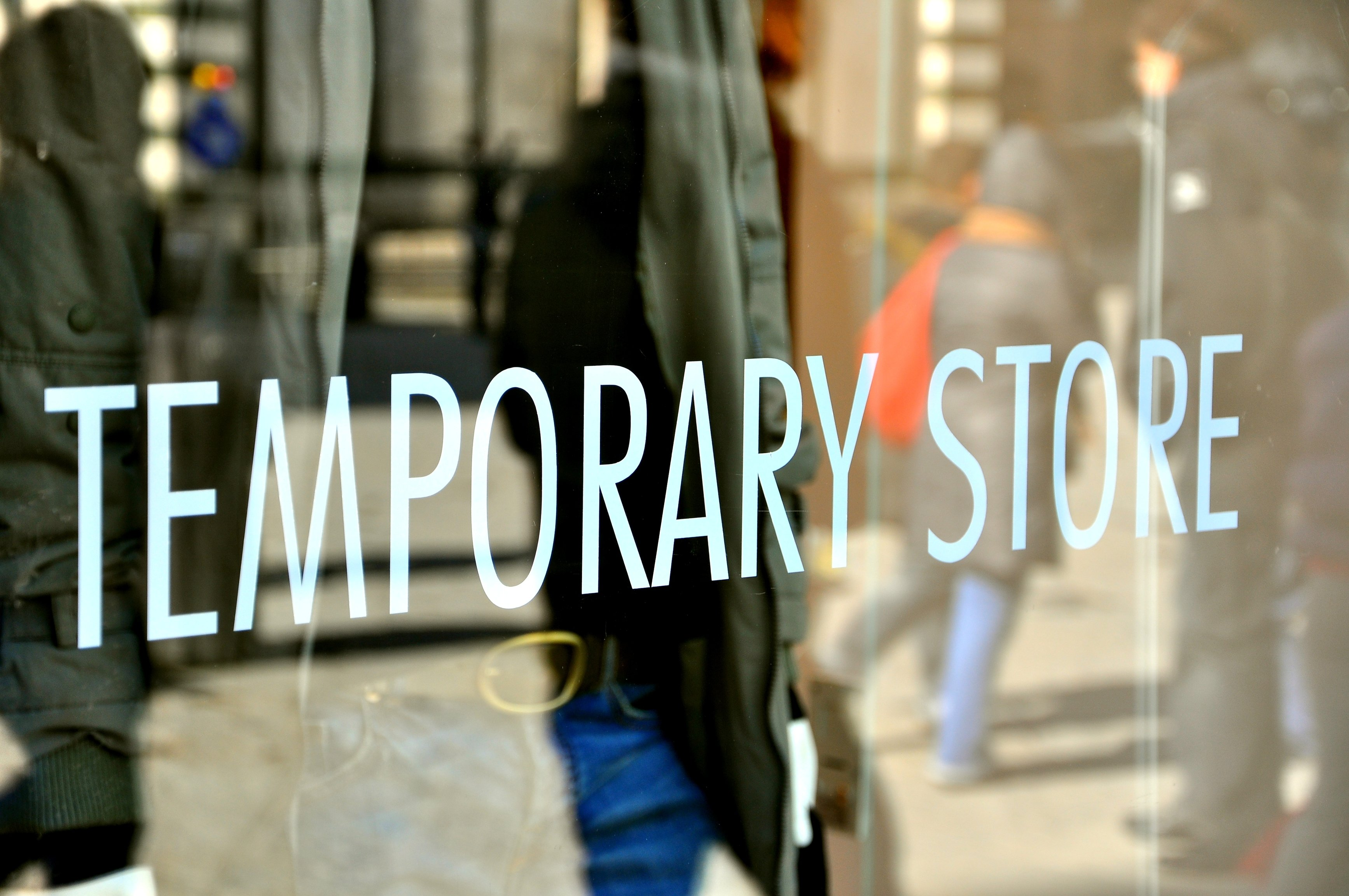 store window with temporary store written on it